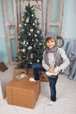 Little boy around Christmas tree Stock Images
