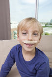 Little boy with artificial mustache smiling Royalty Free Stock Images