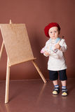Little boy artist brush and paints paints a picture Royalty Free Stock Photography