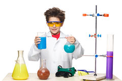 Little boy as chemist doing experiment with Stock Image