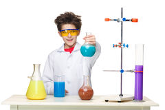Little boy as chemist doing experiment with Stock Photo
