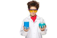 Little boy as chemist doing experiment with Royalty Free Stock Photos