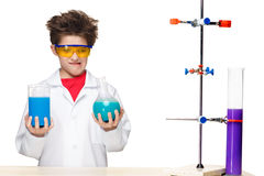 Little boy as chemist doing experiment with Royalty Free Stock Photo