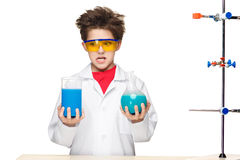 Little boy as chemist doing experiment with Stock Images