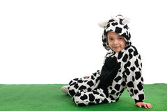 Little boy as happy cow in the meadows Stock Photos