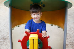 Little boy as helmsman on playground Stock Image