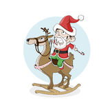 Little boy as santa ride wooden reindeer. Christmas, New Year royalty free stock images