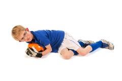 Little boy as soccer keeper. Little blond boy is playing soccer keeper in the studio stock photo