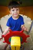 Little boy as steersman on playground Royalty Free Stock Photo