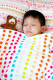 Little Boy Asleep with His Santa Royalty Free Stock Photos
