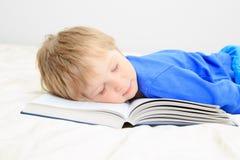 Little boy asleep on open book Stock Photo