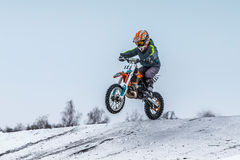 Little boy athlete motorcycle jumping over hill on motocross Stock Photo