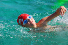Little boy athlete swimming stock images