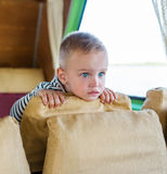 The little boy attentively watches something. Royalty Free Stock Images