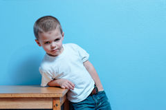 Little Boy Attitude. Little boy with attitude looking straight ahead royalty free stock photo