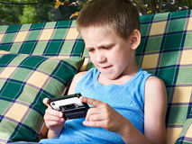 Little boy with audio cassette Royalty Free Stock Image