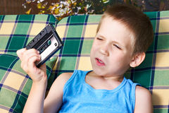 Little boy with audio cassette Royalty Free Stock Images