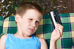 Little boy with audio cassette Royalty Free Stock Photography