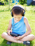 Little boy with audio cassette player and headphones Royalty Free Stock Photography