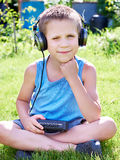 Little boy with audio cassette player and headphones Royalty Free Stock Photo