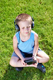 Little boy with audio cassette player and headphones Stock Photography