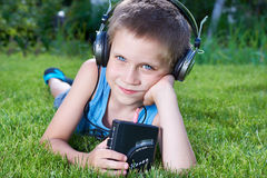 Little boy with audio cassette player and headphones Royalty Free Stock Images