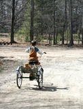 Little Boy auf Trike Stockbild