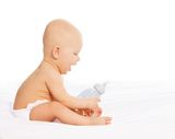 Little boy with baby bottle Stock Photos