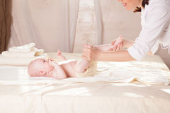 The little boy baby doctor doing massage hands and legs and back. The little boy baby doctor doing massage hands and legs Stock Images