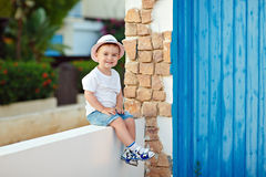 Little boy baby in hat sitting in the house in summer and smiling royalty free stock photos