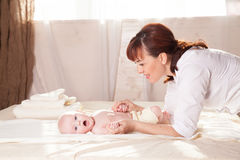 The little boy baby mother doing massage hands and legs. 1 Stock Photos