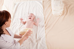 The little boy baby mother doing massage hands and legs. 1 Royalty Free Stock Photo