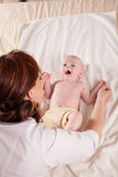 The little boy baby mother doing massage hands and legs. 1 Stock Photo