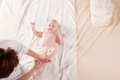The little boy baby mother doing massage hands and legs. 1 Stock Images