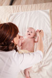 The little boy baby mother doing massage hands and legs. 1 Royalty Free Stock Photos