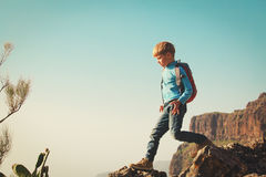 Little boy with backpack travel hiking in mountains Royalty Free Stock Image