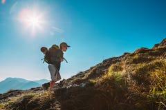 Little Boy backpacker traveler walk up on mountain top royalty free stock photos