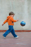 LIttle boy in the backyard with a ball Stock Photography