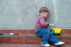 LIttle boy in the backyard Stock Images
