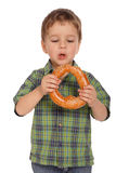 Little boy with bagel Royalty Free Stock Image