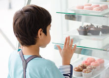 Little boy at the bakery shop Stock Photography