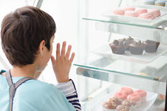 Little boy at the bakery shop Royalty Free Stock Photography