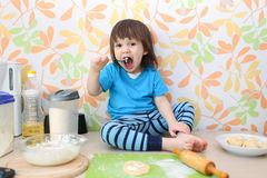 Little boy bakes at home kitchen Stock Photos