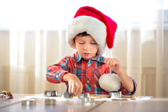 Little boy baking cookies, Merry Christmas Stock Image