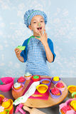 Little boy baking cupcakes Stock Images