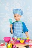 Little boy baking cupcakes Royalty Free Stock Image