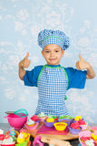 Little boy baking cupcakes Royalty Free Stock Image