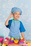 Little boy baking cupcakes Stock Photography