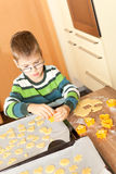 Little boy is baking. Family baking Christmas cookies in the kitchen Royalty Free Stock Photography