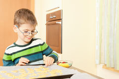 Little boy is baking. Family baking Christmas cookies in the kitchen Stock Photos